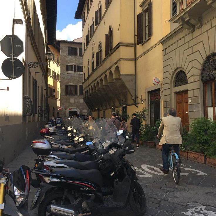I enjoy every moment as I enjoy every picture. — So many bikes in a so little street.  #florencia...