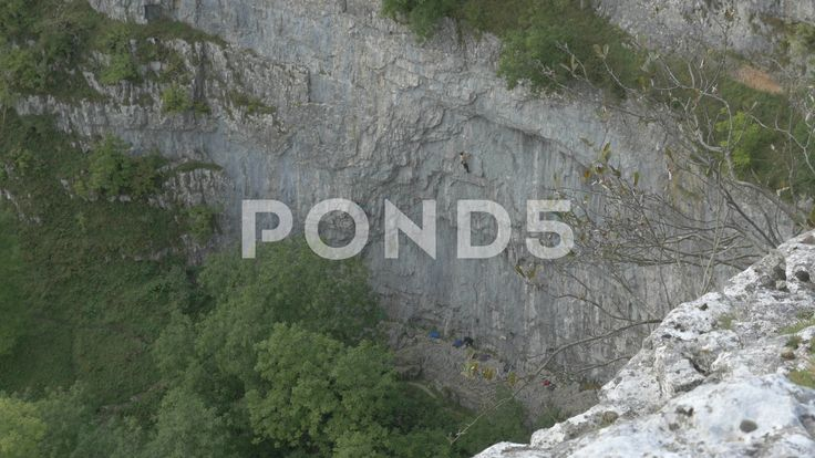 4K Climbers Ascending the Rock Face of Malham Cove Cliff Trees - Stock Footage | by RyanJonesFilms