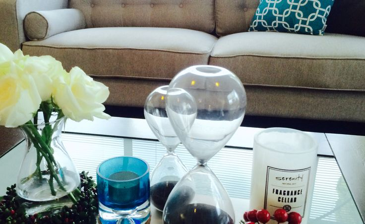 Coffee table simple home decor flowers candles, turquoise and white color scheme.
