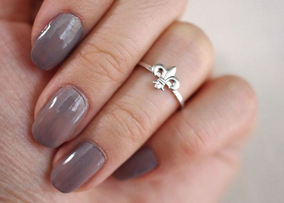 Hey, I found this really awesome Etsy listing at https://www.etsy.com/listing/106898299/fleur-de-lis-midi-knuckle-stacking-ring