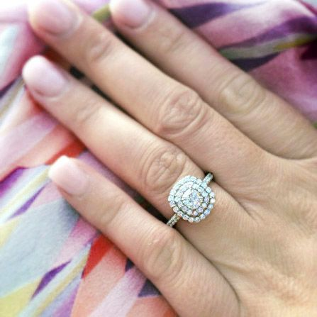 Sally Rose White Label Matthews - 18ct White Gold handcrafted Double diamond halo engagement ring, with a central cushion cut diamond, scalloped claw set halos and diamond shoulders. This ring is meticulously set with the perfect balance of wow factor and class.