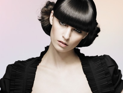 The Electric Collection defines a philosophy of creating beautiful, distinctive style. Hair that is wearable, healthy, luminous and versatile. To create this alternative look a clean centre parting was taken from behind the fringe section through to the nape. The two remaining sections were simply twisted up into two oval buns and pinned. Small sections of hair were pulled out to add interest and soften the style. Hair byMark Woolleyand the Electric Artistic Team Photography byPaul Winter