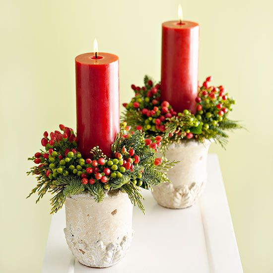 Simple Centerpieces:  Wreath-Inspired Candles  Ring a merry wreath around holiday-hue candles for a quick centerpiece. Fill a small watertight vase or planter with wet florist's foam. Tuck in pine sprigsweave and vibrant hypericum berries for color. Secure candle into vase using florist's picks