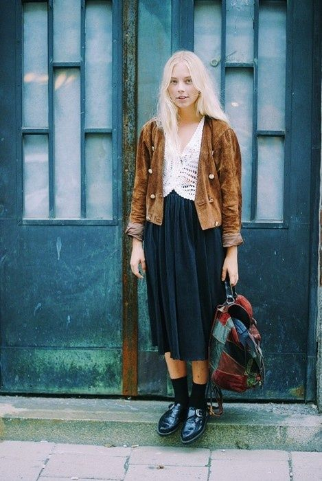 masculine jacket, delicate blouse, long pleated skirt, black socks, black shoes | More outfits like this on the Stylekick app
