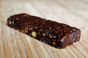 No-bake Choco Chia Cherry Bar:1 c pitted dried dates,1 tbsp honey,1 or 2 tbsp cocoa powder, 1 or 2 tbsp chia seeds,1 tbsp zest of lemon, pinch of salt,1 or 2 tbs dried tart cherries, 3 tbsp chopped almonds,1 or 2 tbsp granola.Mix all the ingredients and process until the mixture clumps together. On a lightly greased baking sheet, press the mixture. Chill in the freezer for 15 minutes; then cut into equal-sized bars. Makes 4 or 5 bars