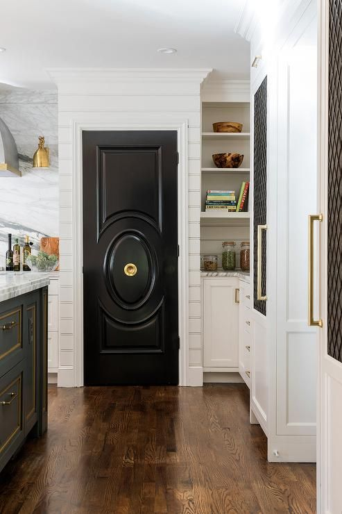 Glossy Black Kitchen Pantry Door Makes A Bold Statement Surrounding Shiplap White Shaker Cabinets And Brass White Shaker Cabinets Black Cabinets Black Doors