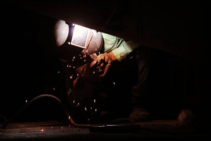 #man #at #work #worship #greatman #hari #thapa #sitejob #welding #pipeline #holder #rod #helmet #gloves #spark #light #shadow #dark #iloveit #myfavpic #picoftheday #industrialart #lightindark #photo #photography #photoshoot #pbhargav