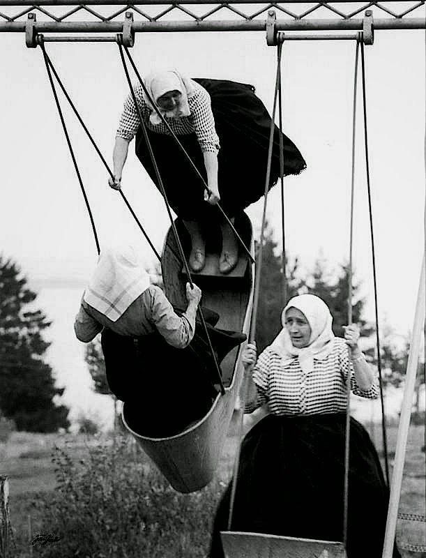 """Jirí Jíru - Swinging grannies, Slovakia, 1966. From """"Poetry of Totalitarian Regime"""", Prague."""