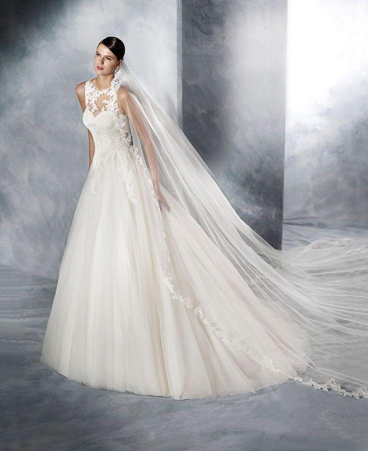 Retrouvez les robes de mariée White One · Fleur d'Oranger