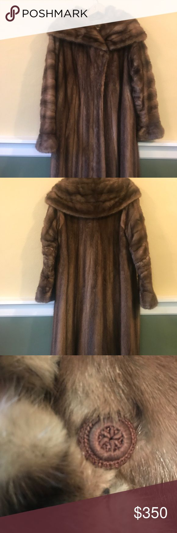 Vtg Mink Coat Sz-M by David L. Norton Holland, MI Vtg Mink Coat Sz-M by David L. Norton Holland, MI. A few fur separation spots typical for an antique fur. As Is. David L. Norton Holland, MI Jackets & Coats
