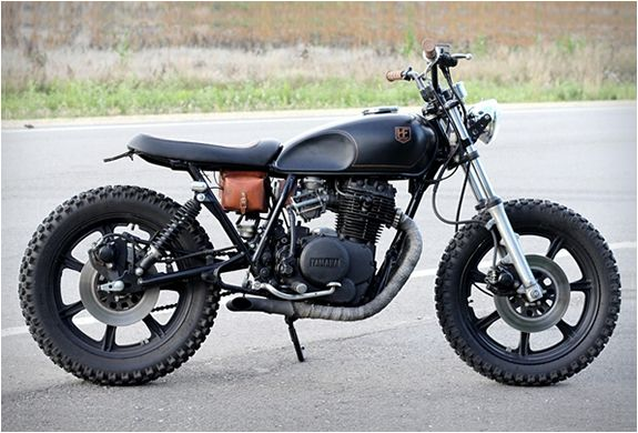 YAMAHA XS400   BY HOLD FAST MOTORS.  Pipes, seat (longer), tank is interesting, and that leather pouch is a nice touch