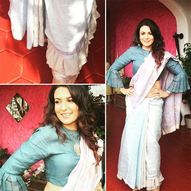 Mini Mathur wows in an awsome handloom sari over a bell-sleeved blouse. She Wears Handloom. Do you? GiftPiper.com- committed to the cause of Indian weaves and crafts.