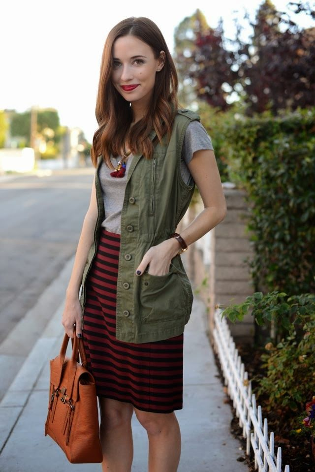 Fall layers to wear when it's not cool yet. Utility vest or jacket over a Tee with a striped skirt