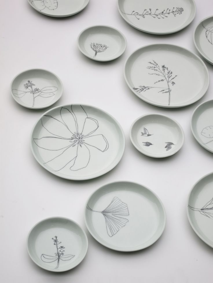 Hand casted and hand drawn plates by Elke van den Berg & Maartje van den Noort