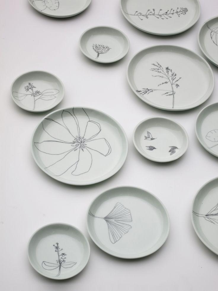 Hand casted and hand drawn plates by Elke van den Berg & Maartje van den Noort