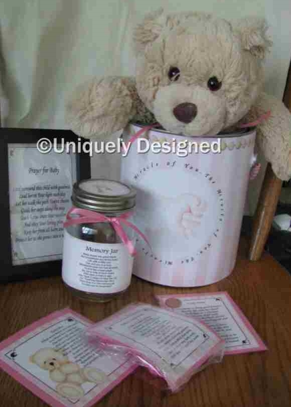 """The Miracle of You set is a great set for the new baby. It has a memory jar because who has the time to scrapbook until they are older? Write down """"baby walked on May 10"""" or """"lost tooth on June 14"""" and remember when you scrapbook later.   It also includes prayer for baby, My first teddy and teddy bear poem. As well as a poem for baby's feet and pair of socks. Can may be personalized if you wish. We have pink, blue, and purple.   Order at: www.uniquelydesigneditems.com"""