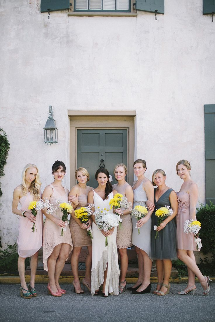 bridesmaids in neutral tones of blush, pink and grey with yellow florals / photo by leslie-hollingsworth.com