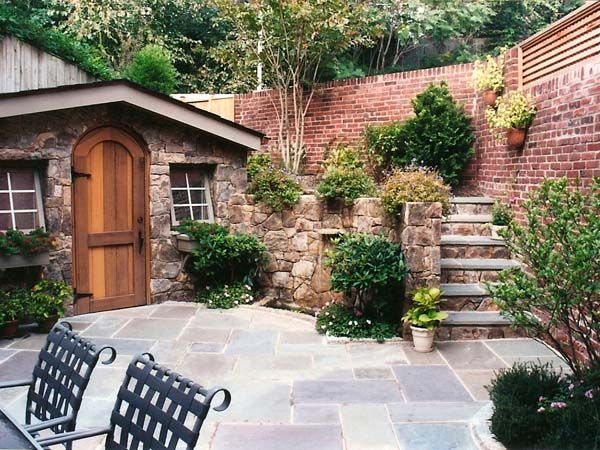 stone garden shed and garage with flagstone patio in a georgetown backyard