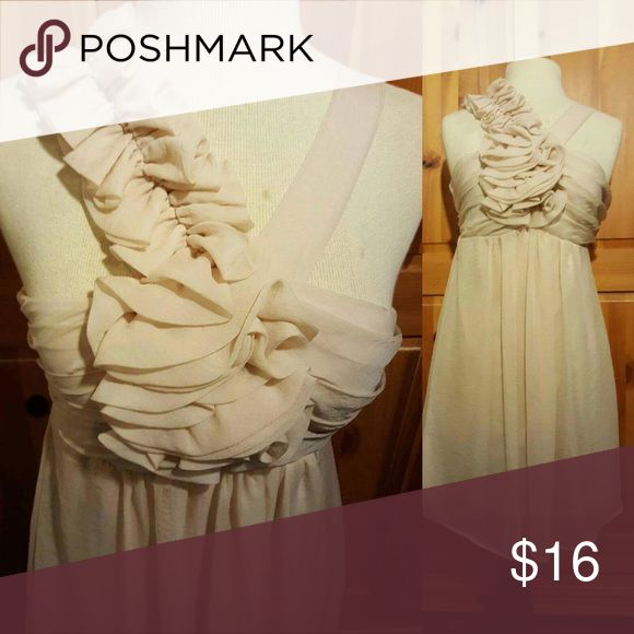 Cream Mini Dress Sweet mini dress. With a beautiful cross crops straps. NWOT. This dress is light weight and comfortable and is 36 in in length. Questions below. Reasonable offers considered. Same day shipping on purchases made before 2 PM PST Dresses Mini