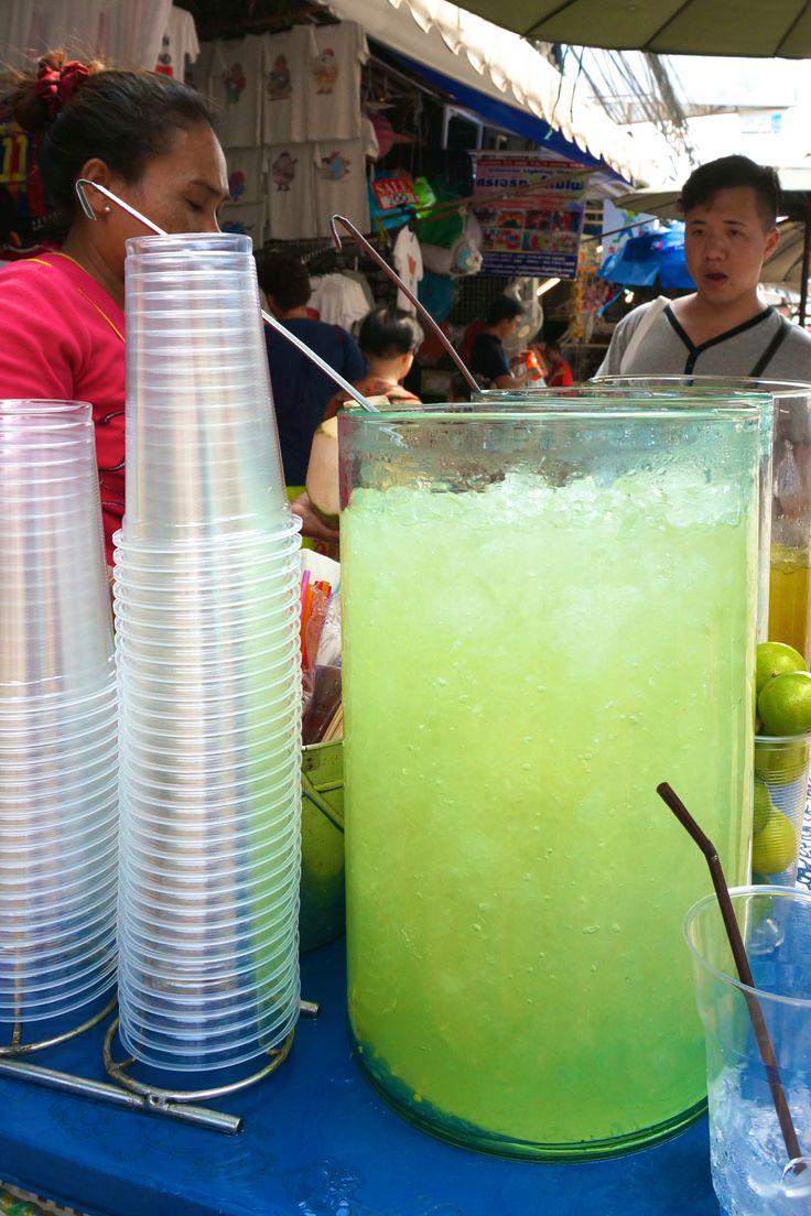 Refreshing icy lime drinks from a street vendor in Bangkok, Thailand at Chatuchak market.