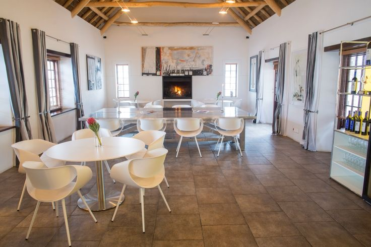 New Tastingroom with fireplace, contemporary furniture by Dauphin and art by Emil Sogor