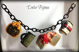 Un Dolce Bijoux: Bracciale con catena in seta nera e 5 borsine in miniatura a scelta...