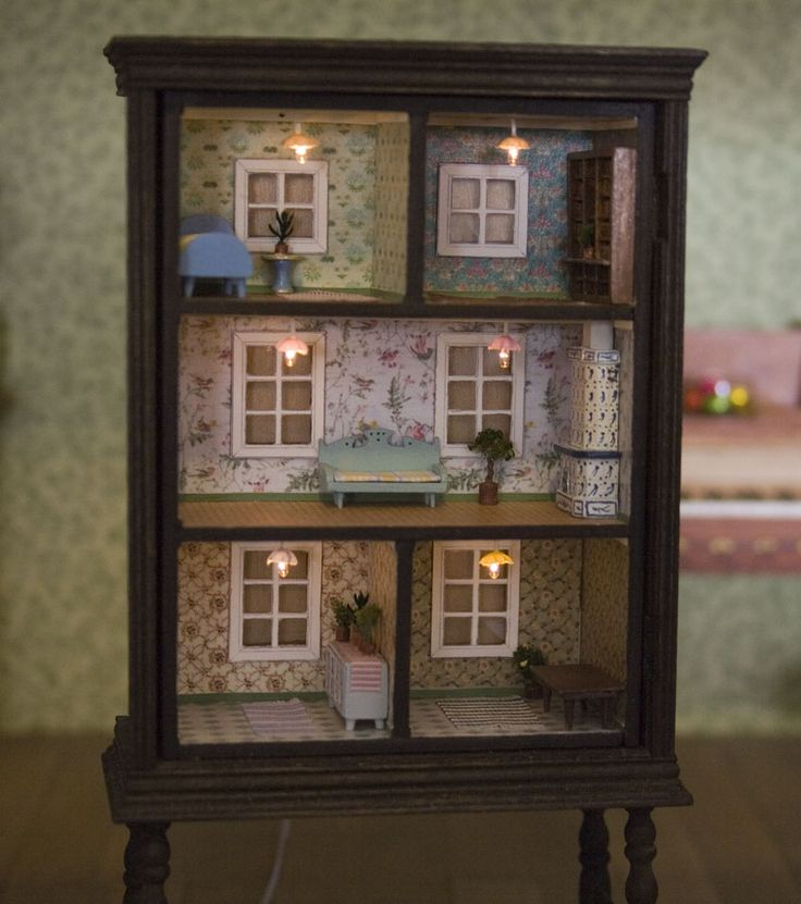 This dollhouse is made from a old dresser.....cute Tiny lights