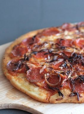 Spicy Pepperoni Pizza with Caramelized Onions on http://twopeasandtheirpod.com This pizza is always a hit!