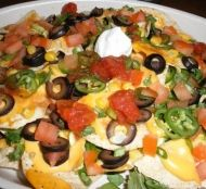 A simple recipe for Best Nachos Ever - with olives and corn