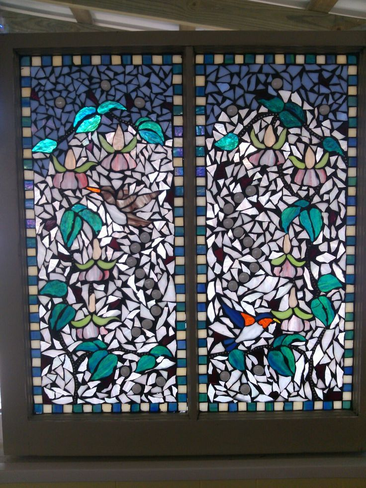 Glass on glass in bird mosaic in old window