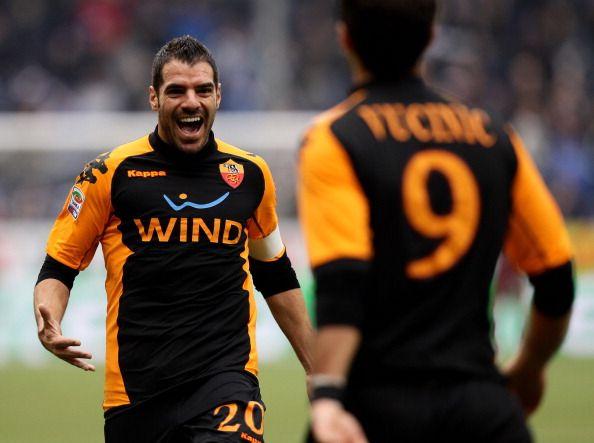 Simone Perrotta and Mirko Vucinic of AS Roma celebrate the Mirko Vucinic goal during the Serie A match between Sampdoria and Roma at Stadio Luigi...