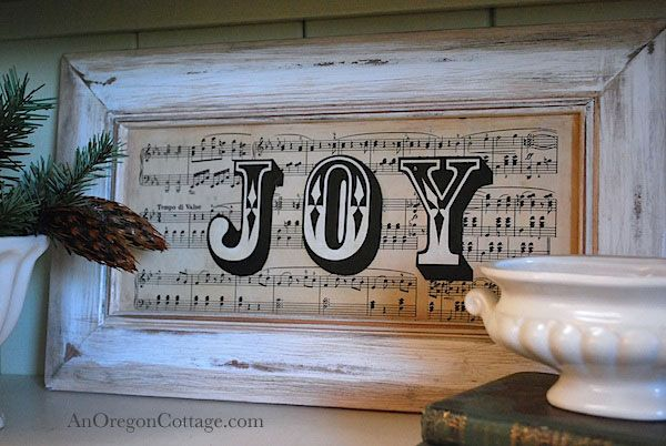 Make a beautiful holiday Vintage Sheet Music Joy Sign from a cast-off cupboard door and printed letters! An Oregon Cottage