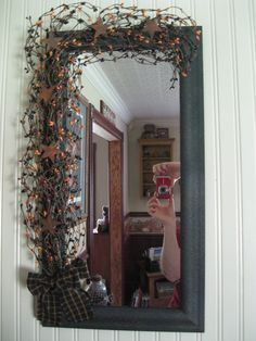 diy primitive mirror. I would want to do it with something other then the bow and starts on it.