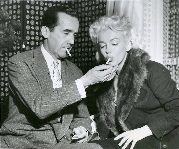 Edward R. Murrow (1908–1965), legendary CBS News journalist and pioneer of television was from Greensboro, NC. His parents were Quakers and lived in a log cabin without electricity or plumbing, on a farm bringing in only a few hundred dollars a year from corn and hay.  (With Marilyn Monroe)