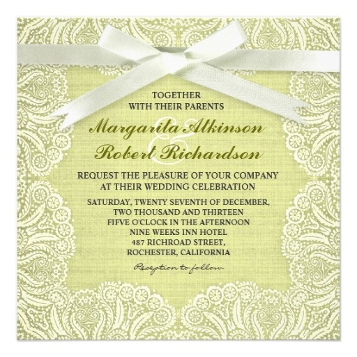 White lace and ribbon, green burlap background wedding invitations