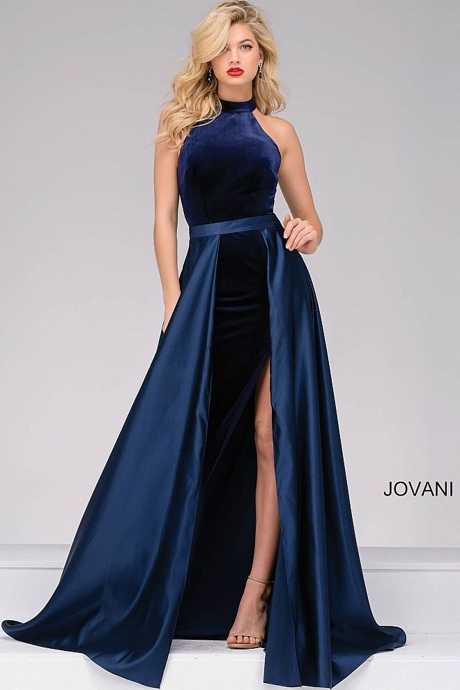 An elegant navy floor length column velvet dress with high slit and a high neckline sleeveless bodice features satin long over skirt, also available in black with hot pink and black with ivory.