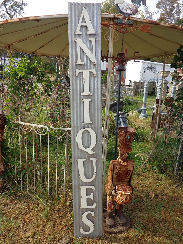 """This is a tall metal wall sign. The word """"Antique"""" is all 3-Dimensional. Nice, heavy, and durable. Could be used for indoor our outdoor use. Measurements: 79"""" Tall 10"""" Wide 1/2"""" Deep"""