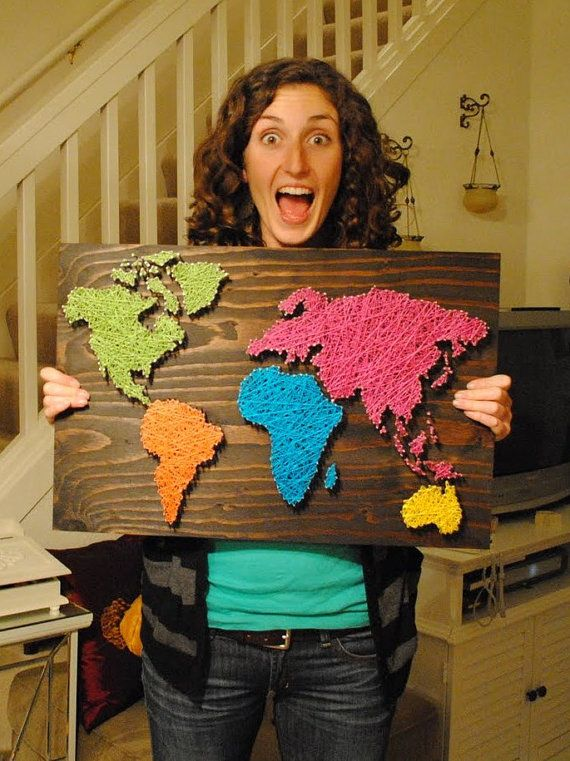 This is so awesome! She made the map on a piece of wood with nails and yarn.