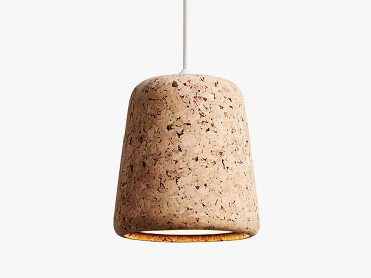 The New Works Material Pendant Light in Cork is a versatile addition to any interior space.