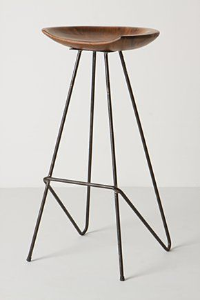 perch barstool: Reclaimed teak is handcrafted into a smooth, polished seat and set atop an architectural frame of sleek steel.