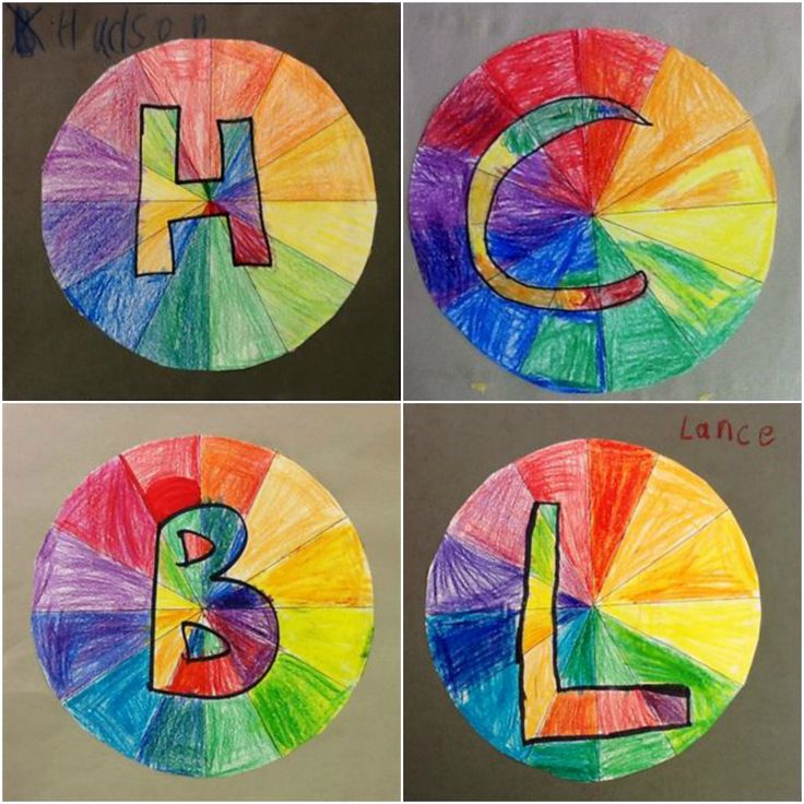 1st grade color wheel initials. Students created the main part of the color wheel using primary, secondary, and tertiary colors. Tertiary colors were made by overlapping crayon colors. Finally, our letters were colored in using complementary colors.