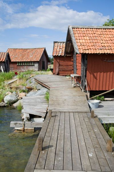 """Fisherman's huts in the Archipelago of Stockholm, Sweden"" Photography by kbhsphoto buy now as poster, art print and greeting card.."