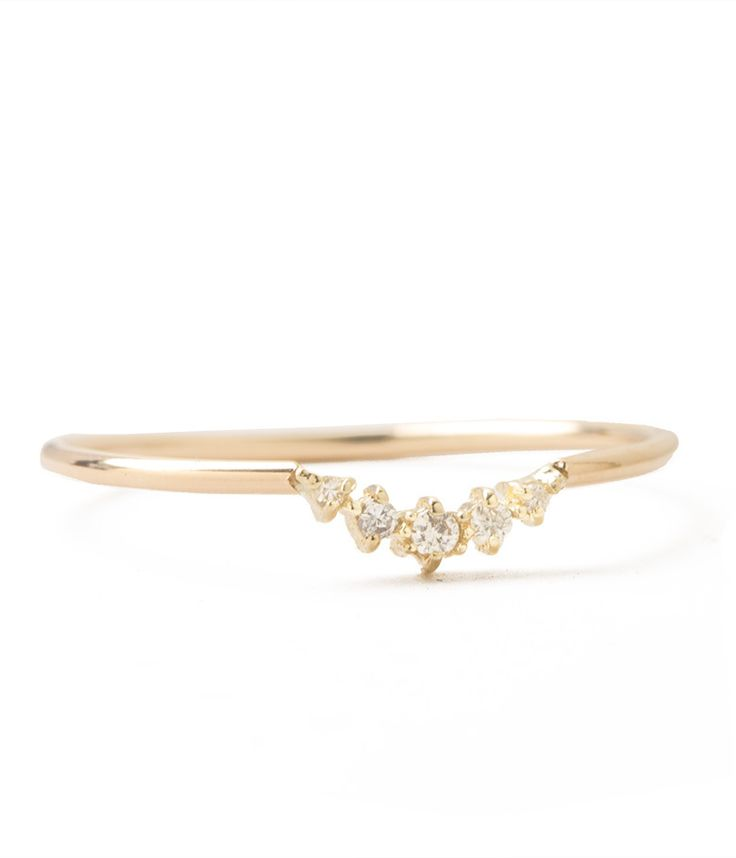 This delicate band places five diamonds in the perfect little arch. Perfectly dainty, unique, and timeless. 14k yellow gold. Worn with:Compass Ring
