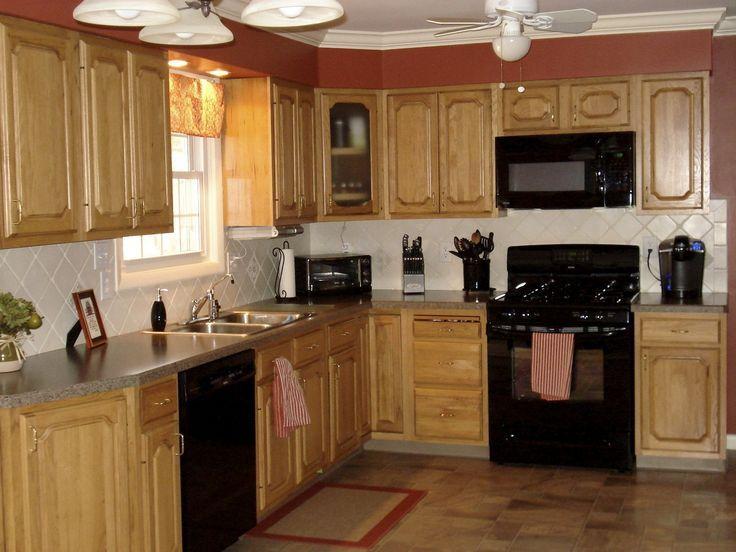 Kitchen With Light Oak Cupboards And White Quartz Worktop Google Search Black Appliances Kitchen Black Kitchens Affordable Kitchen Cabinets