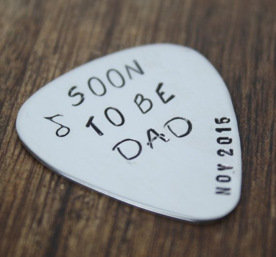 """the first christmas present i ever got jason was a guitar pick that said """"i pick you"""" and had our dating anniversary date on it. this would be a perfect way to announce a baby!"""