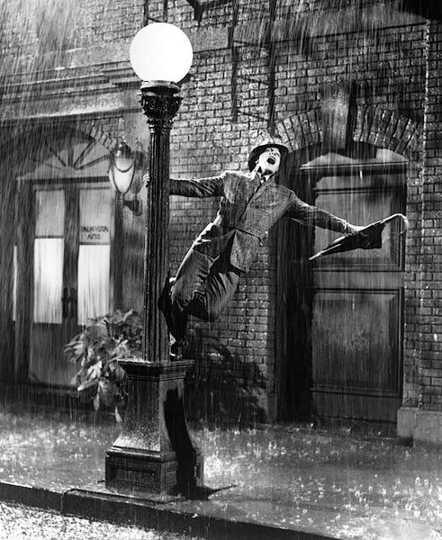 """Singin' in the Rain"" (1952)  Gene Kelly had what Fred Astaire didn't: sex appeal. This is why ""Singin' in the Rain"" is still a thrilling dance movie to watch more than 50 years later. ""Ladies and gentlemen, stop that girl, that girl running up the aisle. Stop her! That's the girl whose voice you heard and loved tonight. She's the real star of the picture. Kathy Selden!"""