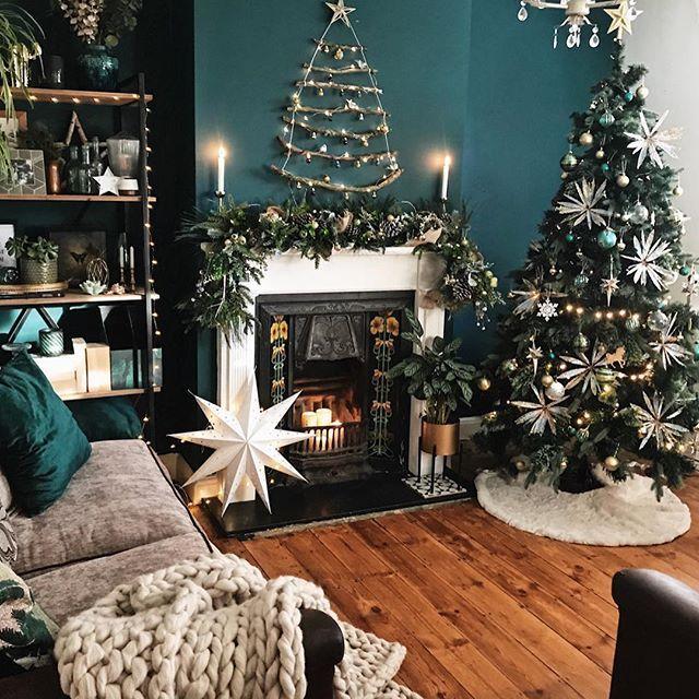 Dark Green Walls Christmas Twig Decoration And Christmas Tree In The Living Ro Christmas Decorations Living Room