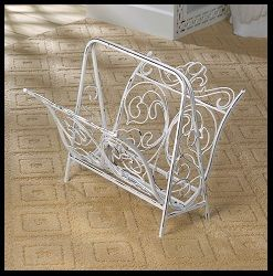 Keep your magazines organized while adding a dash of vintage style to your room. This white cast iron magazine rack features scrolling flourishes and a frame that makes moving it to a new nook easy. The white painted finish is made to look like a time-honored, well-loved home essential. www.mysouthernhomeplace.com