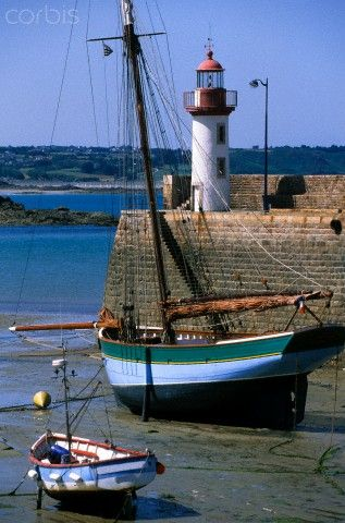 France, Cotes d'Armor, Erquy, rigging and old lighthouse on port