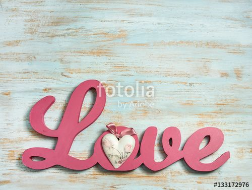 valentines day or wedding background with wooden love word, heart shape and copy space. love concept on shabby chic painted wood